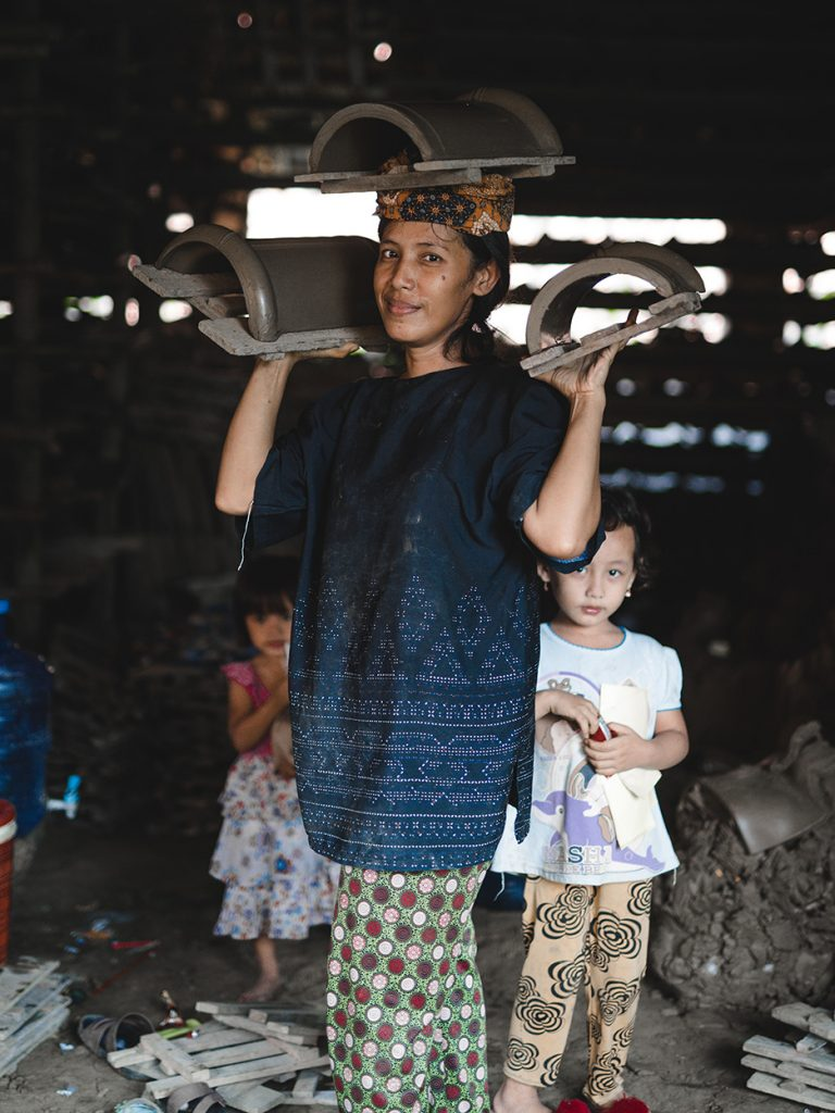 Tile factory worker and her children in Jatiwangi, 2019